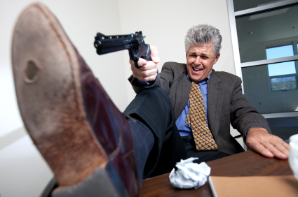 Man aiming gun at his own foot